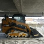 Removing Snow From Parkades and Parking Lots.