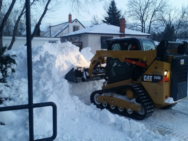 Residential Snow Removal Using a Skid Steer