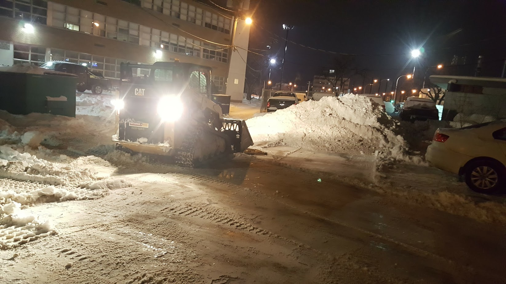 Removing Snow From Parking Area