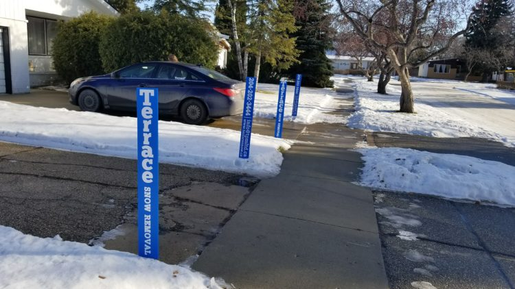 A Pair Of Seasonal Snow Removal Clients With Driveway Markers